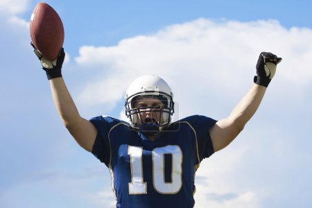 Football Player Celebrating a Touchdown