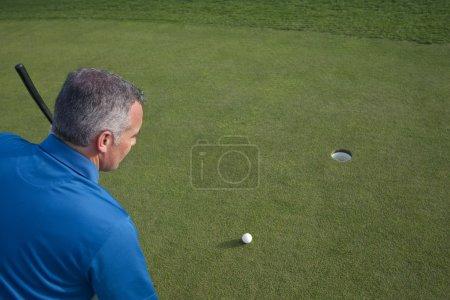 Golfer Ready to Make a Golf Putt