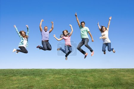 Photo for Fun Group of Young People Jumping Outdoors - Royalty Free Image
