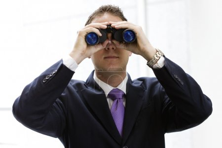 Businessman with binoculars