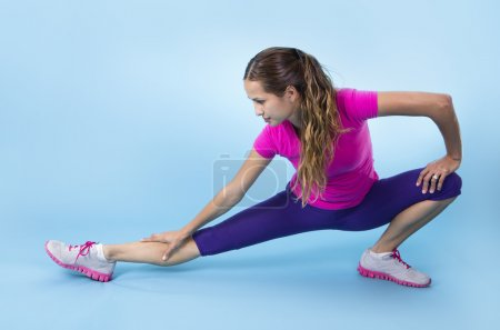 Fitness Woman stretching before a workout