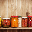 Preserved autumn vegetables on shelf near a brown ...