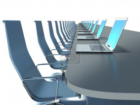 Photo pour Salle de conférence avec table noire et chaises et ordinateurs portables - image libre de droit