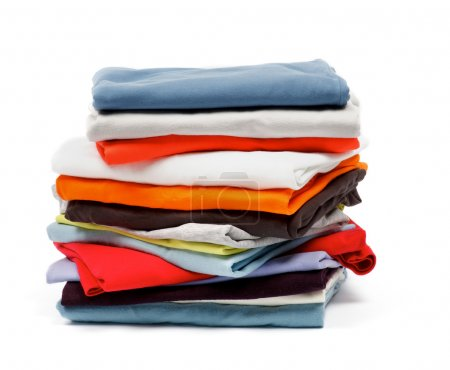 Photo for Stack of Color T-Shirts and Clothes isolated on white background - Royalty Free Image