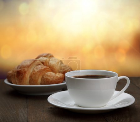 Photo for Morning breakfast - coffee and croissant in sunrise - Royalty Free Image