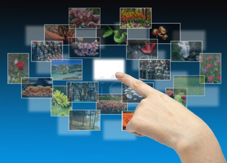 Foto de La mano en el flujo de varios botones  . - Imagen libre de derechos