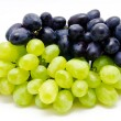 Ripe dark and green grapes isolated on a white...
