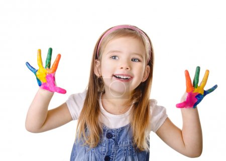 Beautiful smiling little girl with hands in the paint isolated
