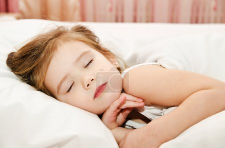 Photo for Adorable little girl sleep in the bed - Royalty Free Image