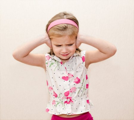Photo for Disappointed little girl covering her ears - Royalty Free Image