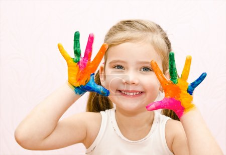 Photo for Cute smiling little girl with hands in paint isolated - Royalty Free Image