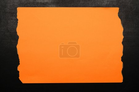 Orange Burnt Paper On Chalkboard
