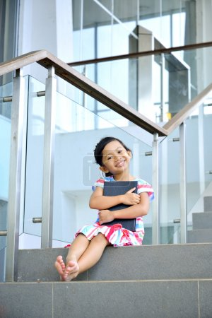 Young Girl Reading On The Stair