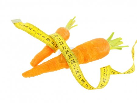 Two fresh carrots with tape measure.