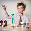 Crazy scientist. Young boy performing experiments...