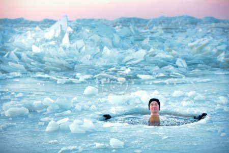 Man bathing in the ice cold water. The Epiphany, celebrated on jan 19 by the Orthodox Church marks the baptism of Jesus.