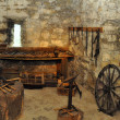 Museum exposition of an blacksmith workshop in a c...