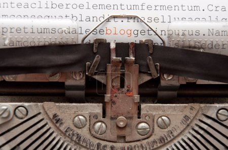 Photo for Word 'blog' and other text written on an old typewriter - Royalty Free Image