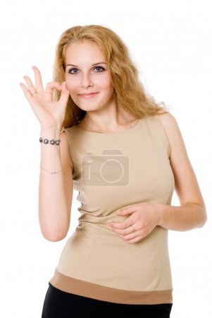 Portrait of attractive businesswoman indicating OK sign