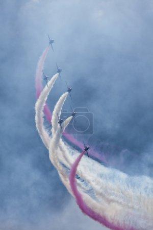 Aerobatic team with smoke trails