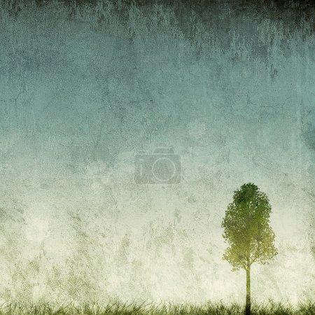 Grunge background with single tree