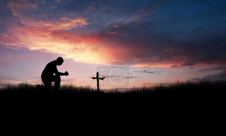 Praying over cross