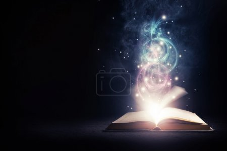 Open glowing book with bright lights and colors...
