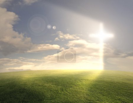 Bright glowing cross on grassy background....