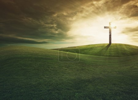 Cross on top of the hill at sunset...