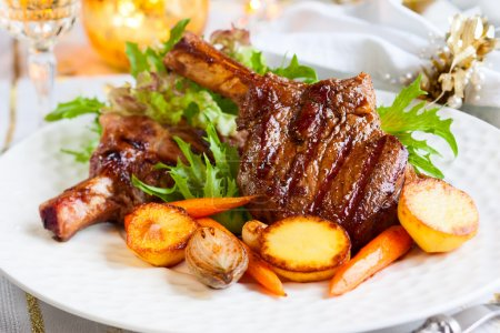 Photo for Veal chop with vegetables for Christmas dinner - Royalty Free Image