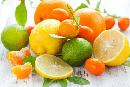 Photo for Citrus fresh fruit on the white wooden table - Royalty Free Image