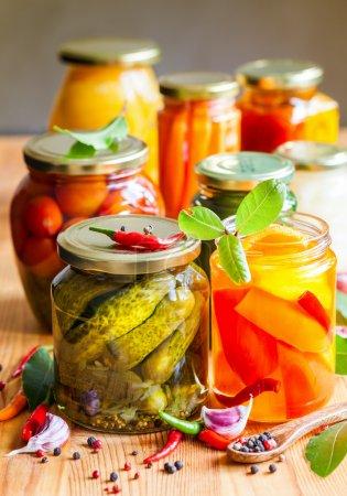 Vegetable preserves on wooden table...