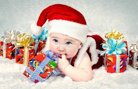 Cute little santa baby with New years gifts