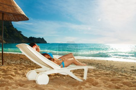 Young beautiful girl relaxing on beach