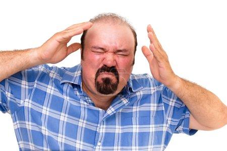 Enraged man wringing his hands