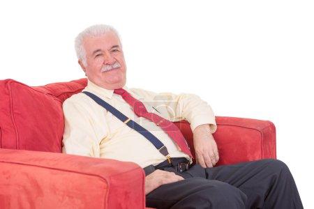 Senior gentleman relaxing in an armchair