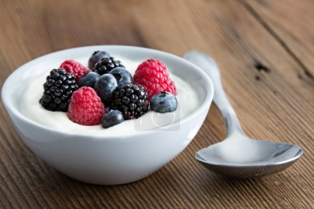 Bowl of fresh mixed berries and yogurt