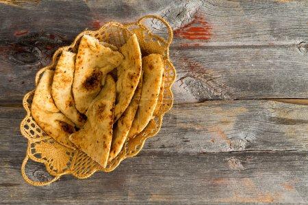 Delicious crusty naan flatbread slices in a basket