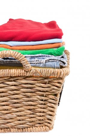 Wicker basket of clean fresh laundry filled with n...