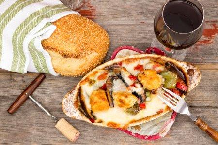Tasty chicken casserole with sesame bread