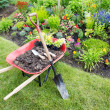Garden work being done landscaping a flowerbed wit...