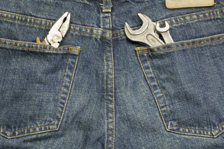 Working tools in jeans pockets