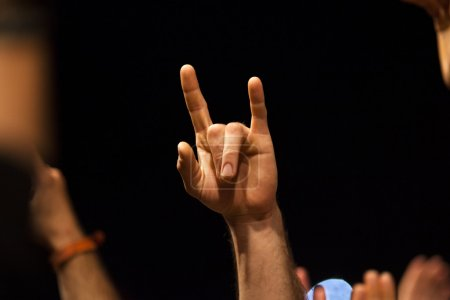Photo for Hand fingers show heavy metal rock gesture - Royalty Free Image