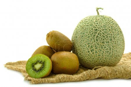 Netted melon and kiwi on white background