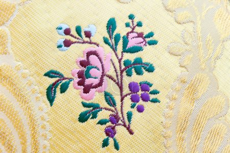 Silk embroidered in yellow fabric...