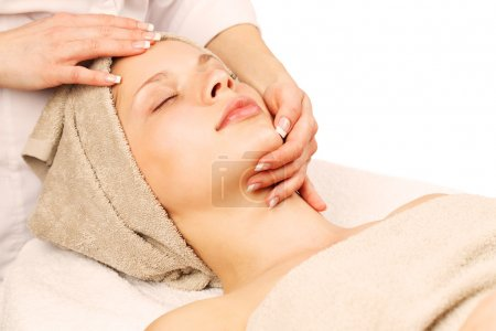 Facial massage at day spa