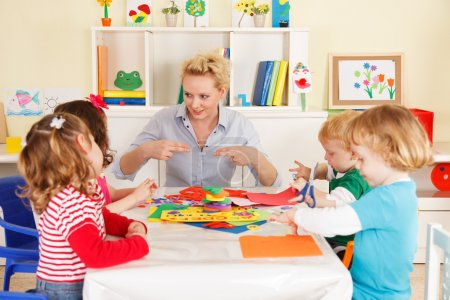 Photo for Pre-school children in the classroom with the teacher - Royalty Free Image
