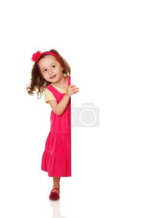 Girl holding a blank placard