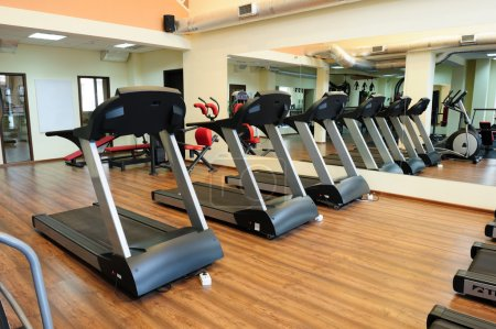 Photo for Set of treadmills staying in line in the gym - Royalty Free Image