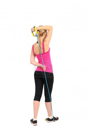 Female triceps extension exercise using rubber resistance band